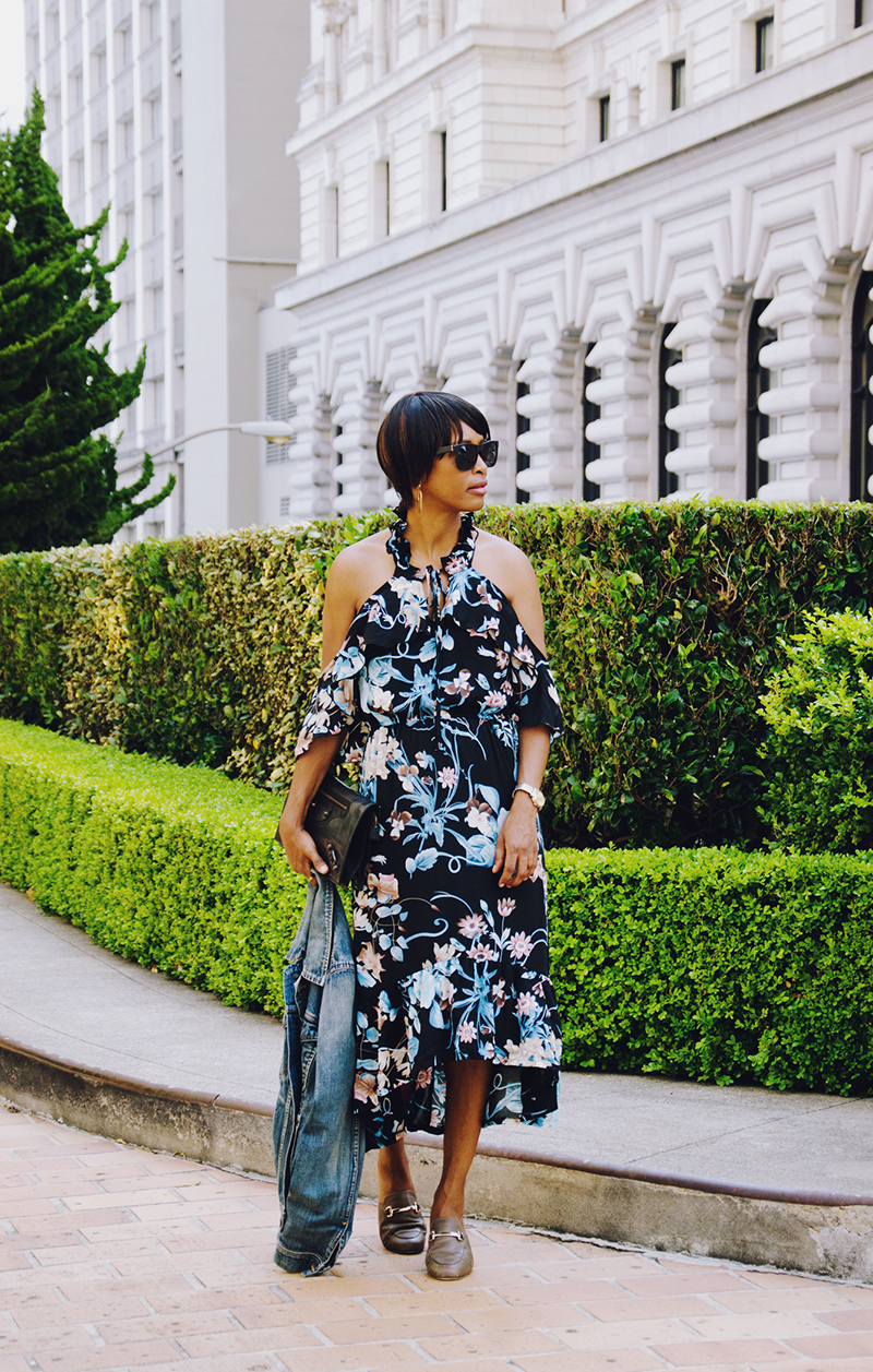 blue floral dress black clutch
