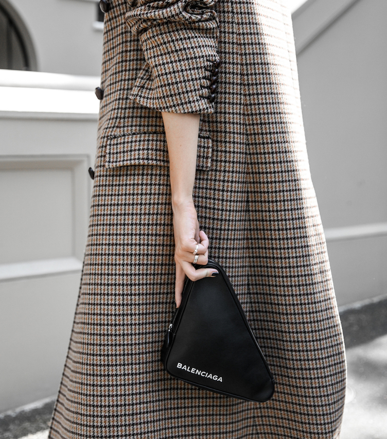 modern legacy balenciaga triangle bag houndstooth coat