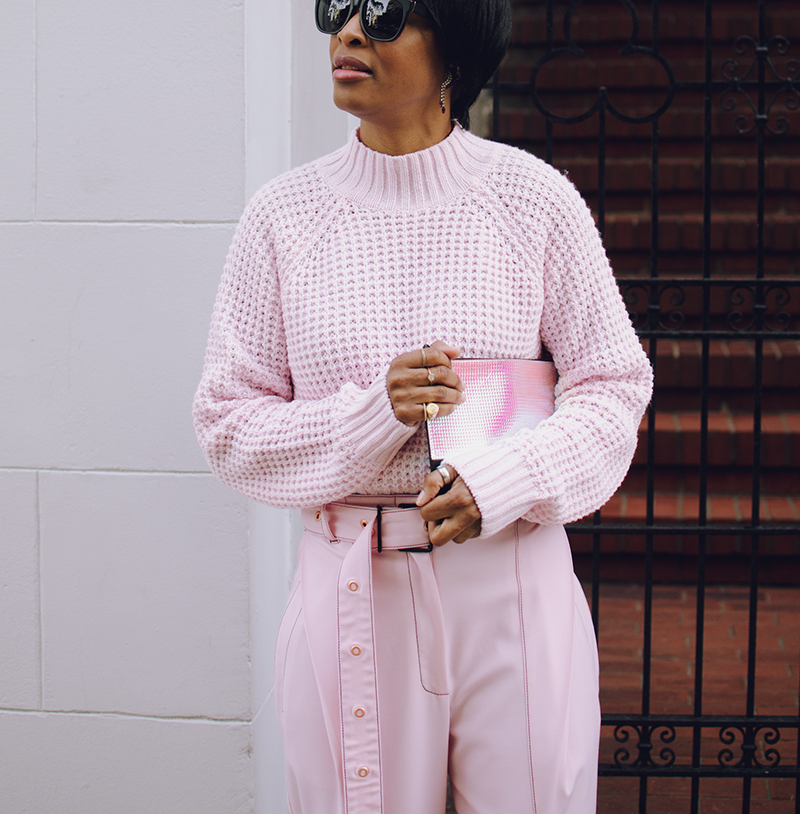 pink mockneck sweater mirrored clutch
