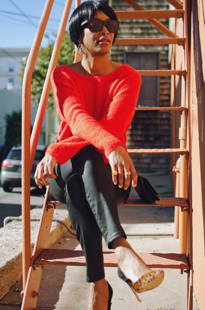 statement earrings red ribbed sweater