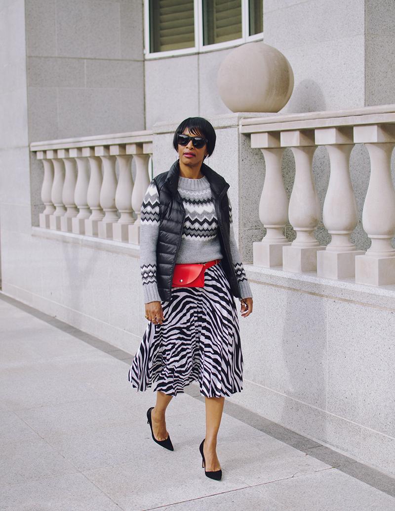 red belt bag pleated skirt