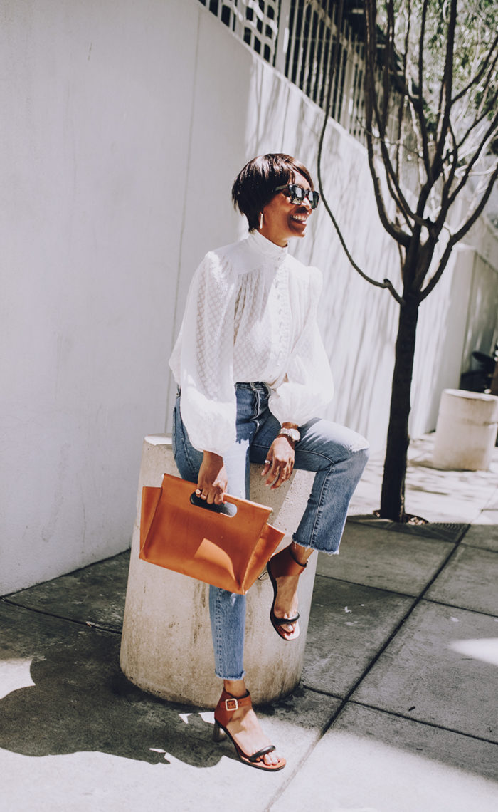 spring outfit white blouse light wash distressed jean