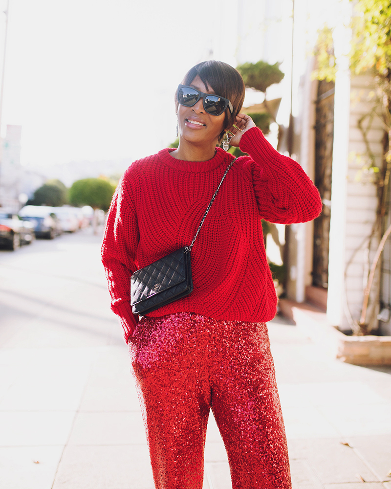 red chunky sweater chanel wallet on chain holiday look