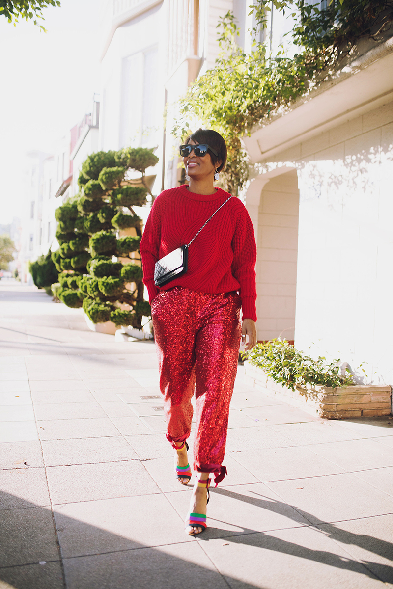 red sweater red sequin pants chanel wallet on chain