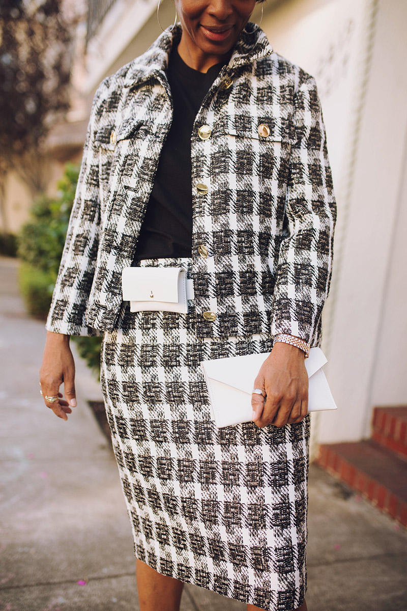 black and white houndstooth suit white clutch