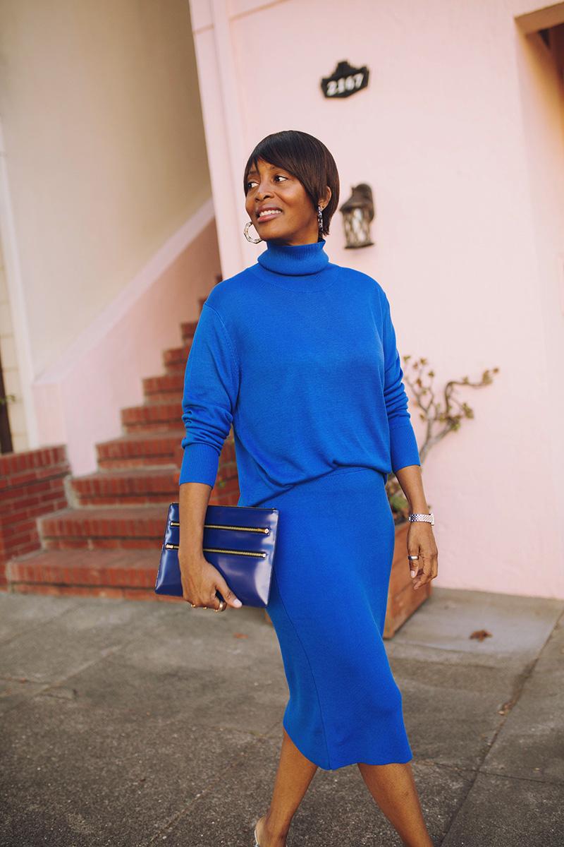 blue turtleneck blue sweater skirt zipper clutch