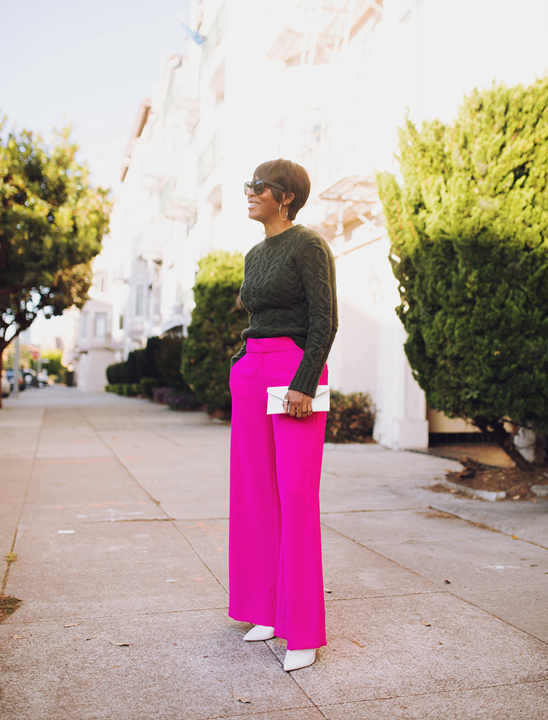 magenta wide leg pant olive cabled sweater white envelope clutch